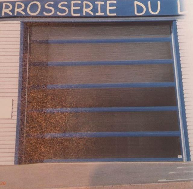 Porte sectionnelle lumitec la toulousaine ascenseur modernisation service - La toulousaine porte sectionnelle ...
